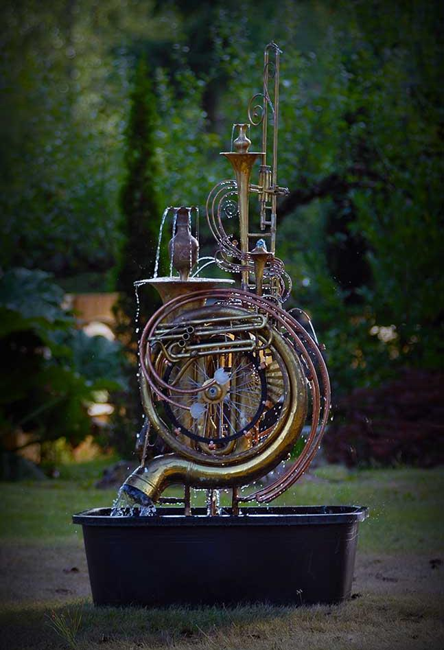Musical instrument fountain made from upcycled copper tube, two tubas, a trumpet, a bicycle wheel and an assortment of copper and brass collectables. It comes complete with pump. This fountain is currently available for purchase @ $ 3,500. Please call or email for further info and shipping details.