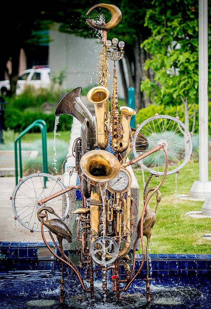 Water fountain sculpture, City Hall, Castlegar, BC.  This musical instrument fountain sculpture was the recipient of the Castlegar Sculpture Walk 2013 People's Choice award and purchased by the city. Its permanent home is in front of City Hall in Castlegar. Materials include copper tube, upcycled musical instruments, tubas, trumpets, a trombone, bicycle wheels, brass and glass pieces.