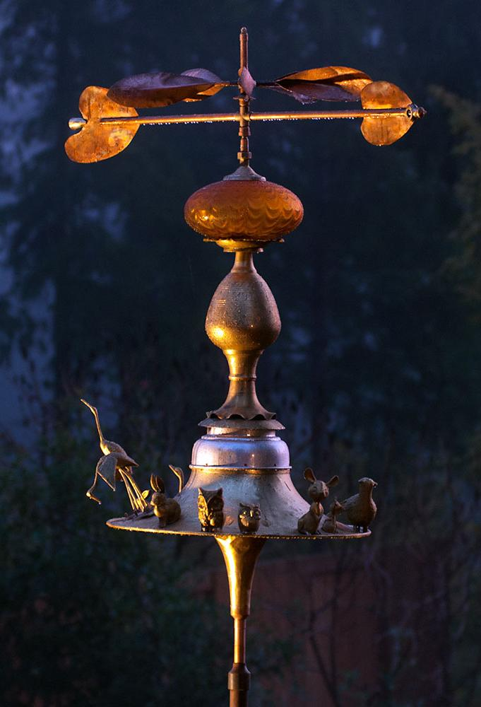 Weather vane made from an upcycled trumpet, a sousaphone bell and brass and copper.